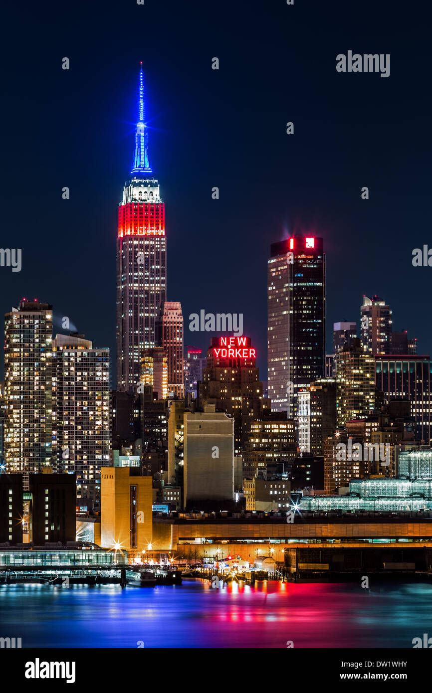 Empire State Building By Night The Top Of Iconic Skyscraper Displays American Flag Colors Blue White Red In Honor