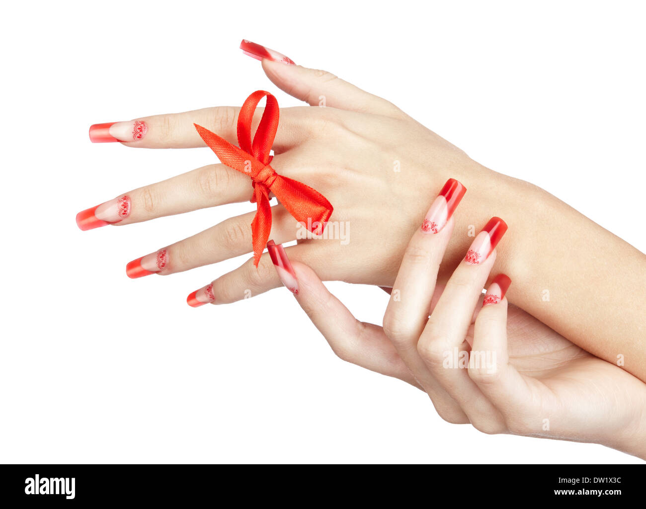 Hands with red french acrylic nails manicure and painting with bow ...