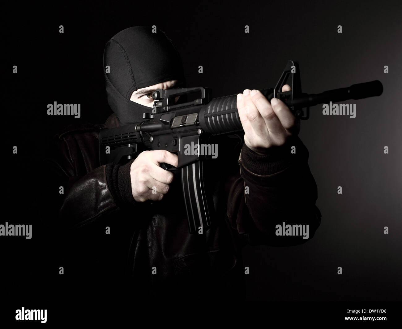 terrorist with rifle - Stock Image