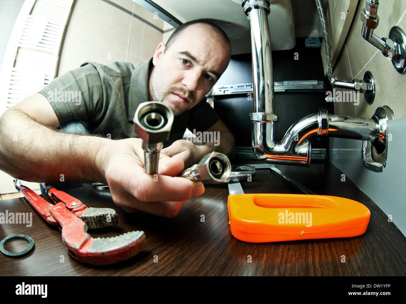 plumber at work - Stock Image