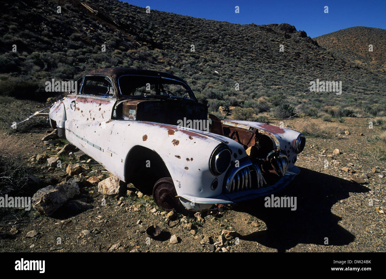 Elk248-2479 California, Death Valley National Park, Harrisburg, old rusted out car - Stock Image