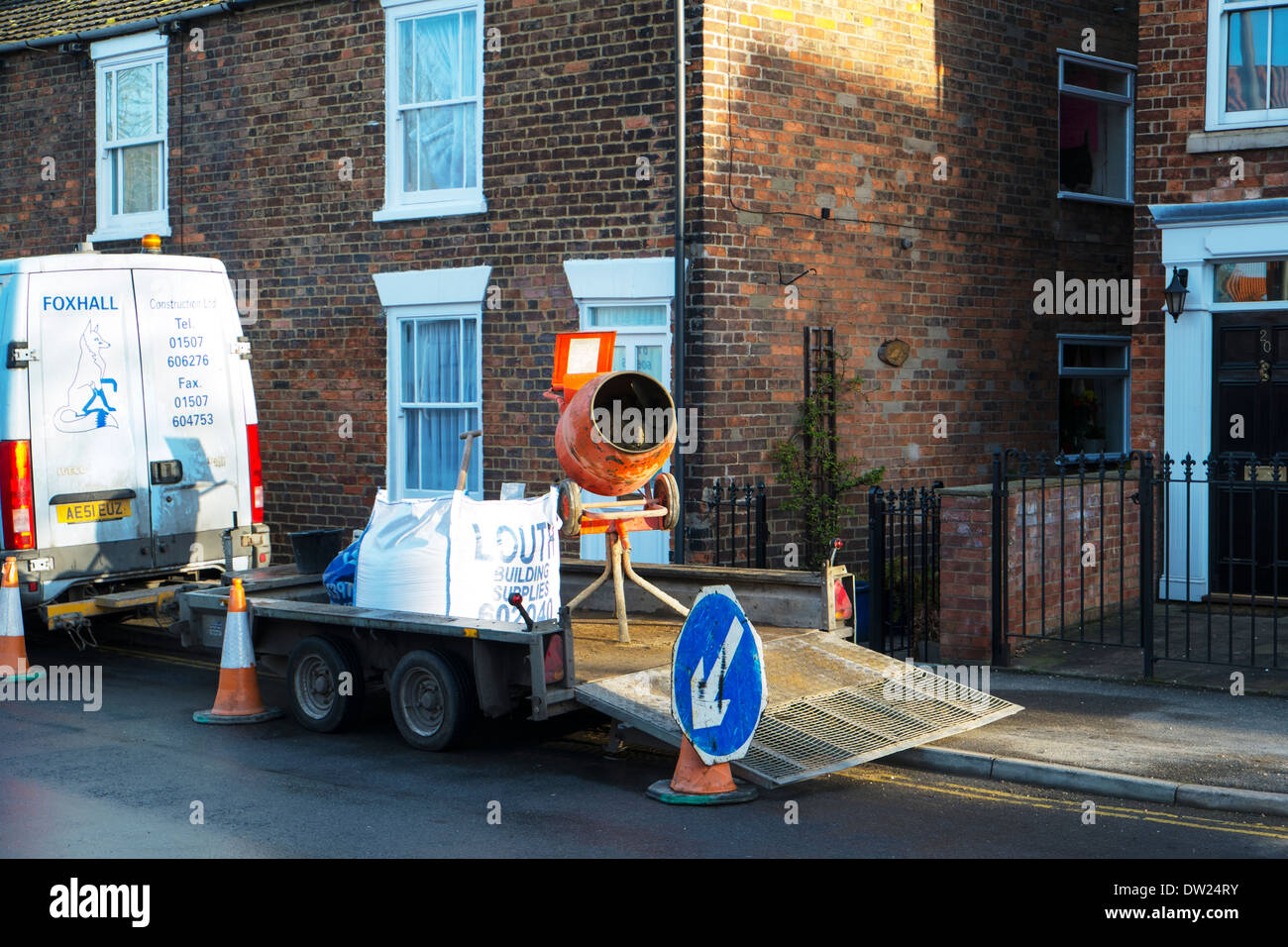 Cement mixer and sand on trailer builders machinery tools machine - Stock Image