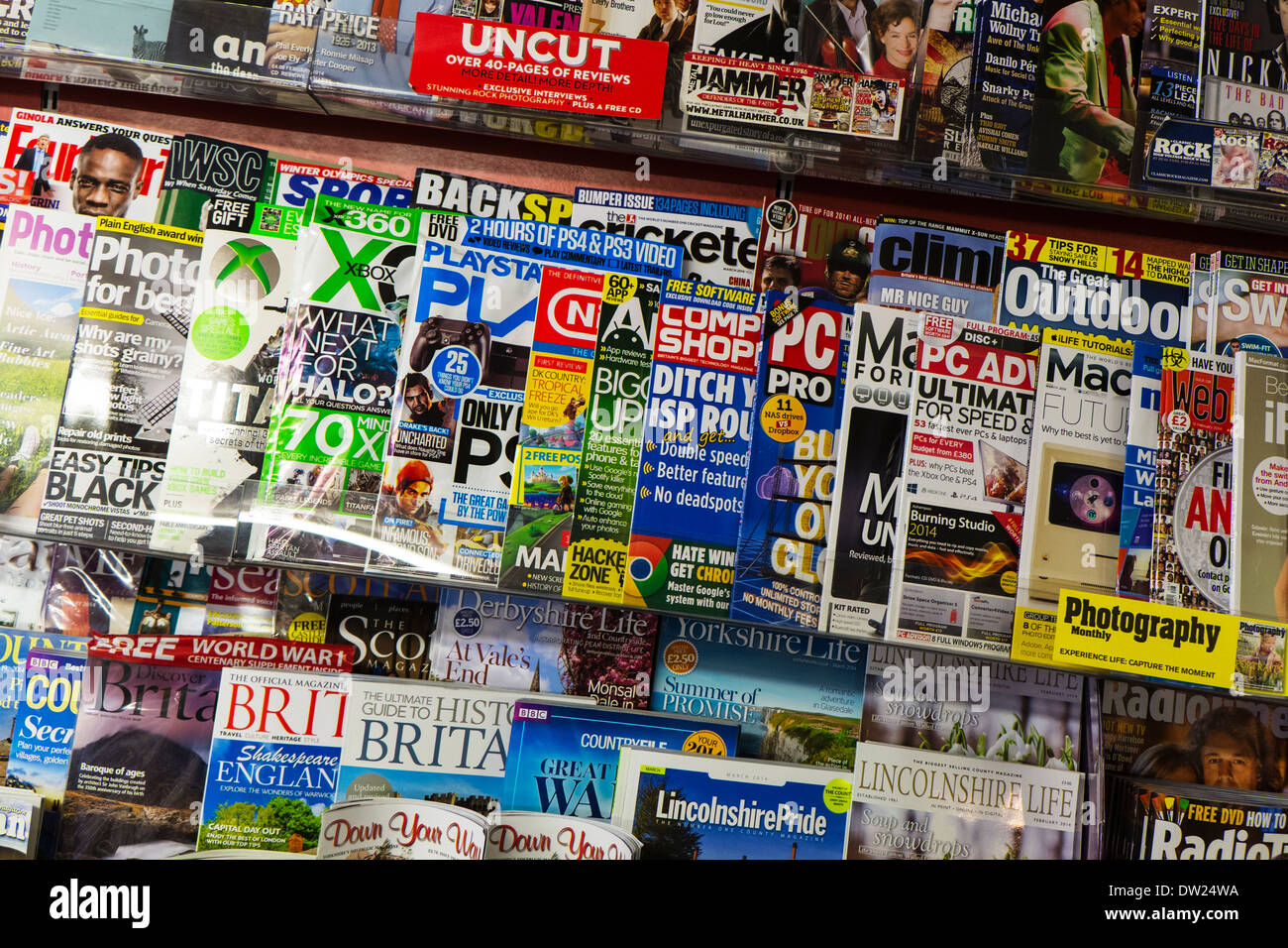 Magazine display stand in stationary shop store computer games mags mag selling - Stock Image