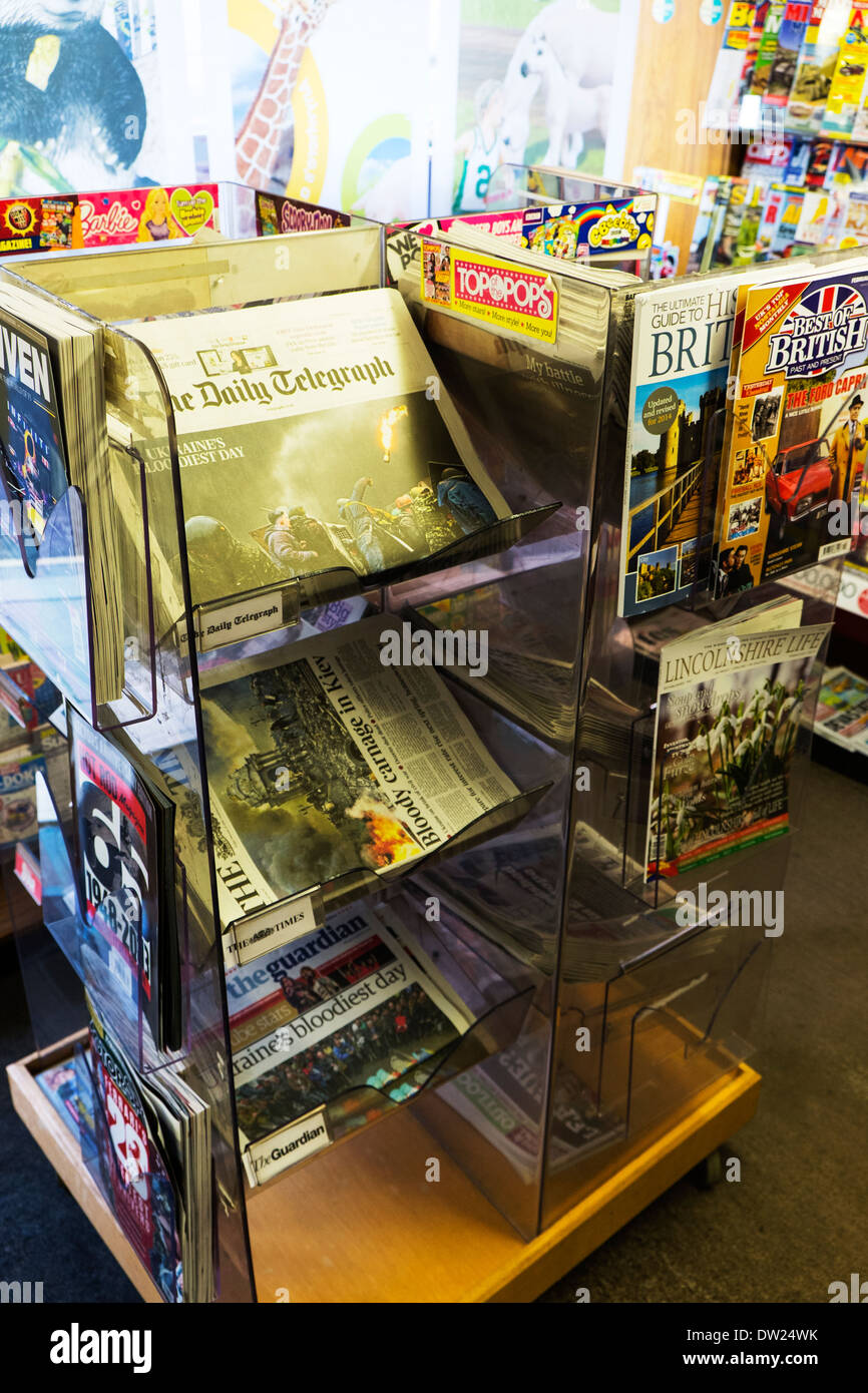 daily newspaper display stand in stationary shop store stationers papers - Stock Image