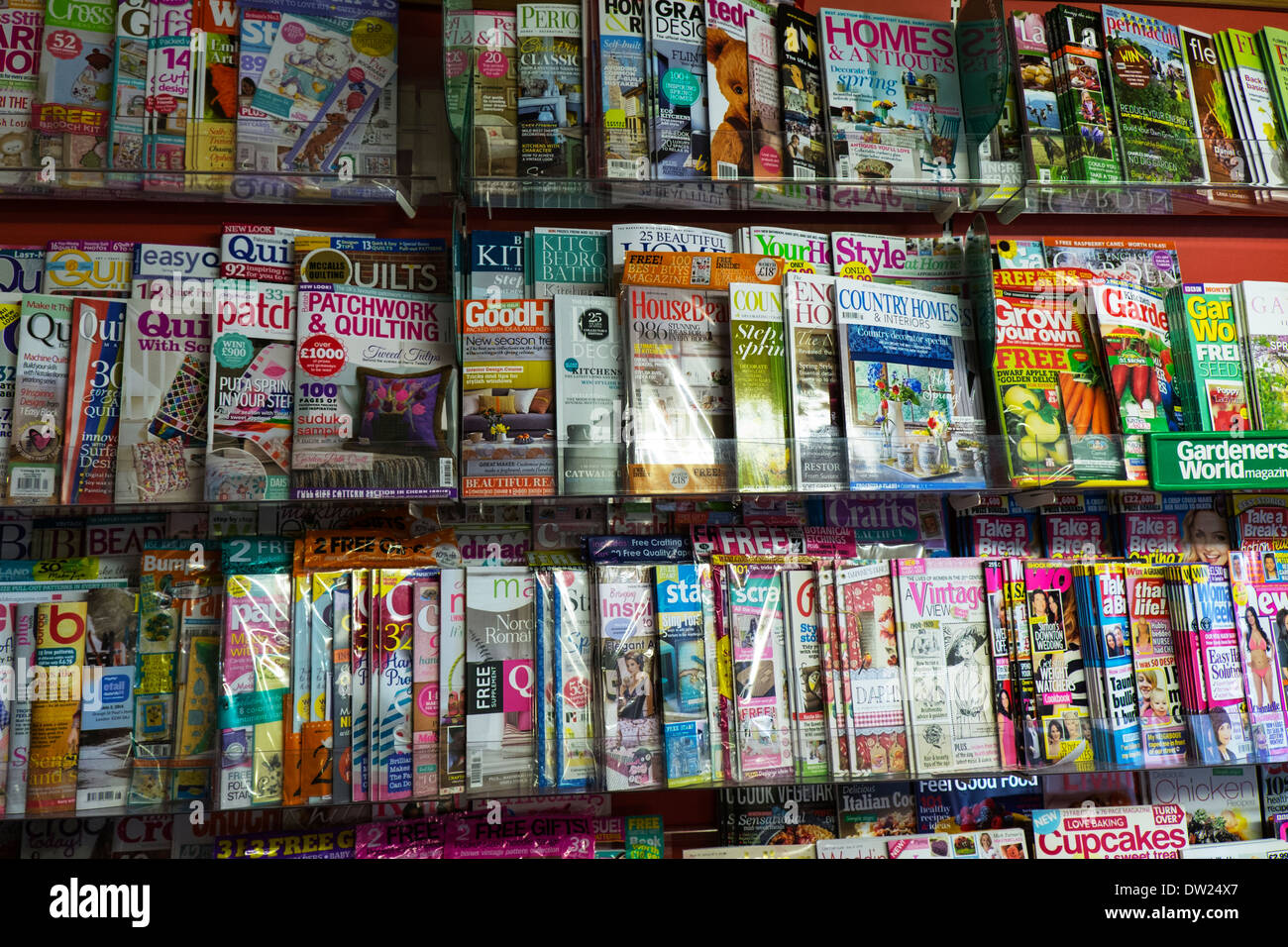 Magazine display stand in stationary shop store good housekeeping mags mag selling - Stock Image