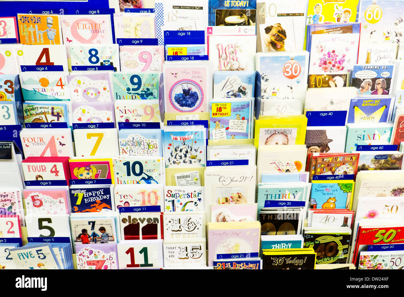 Birthday cards greetings card shop display ages age on card - Stock Image