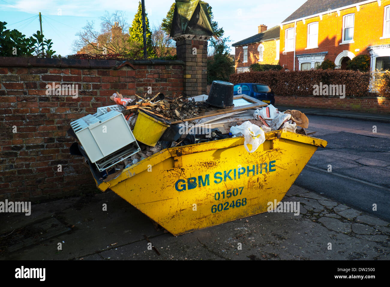 Skip full of rubbish hire removal service Louth town Lincolnshire England UK GB - Stock Image