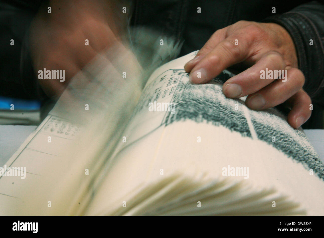 Yangzhou, China's Jiangsu Province. 25th Feb, 2014. A worker counts pages at the Guangling Ancient Books Printing Stock Photo