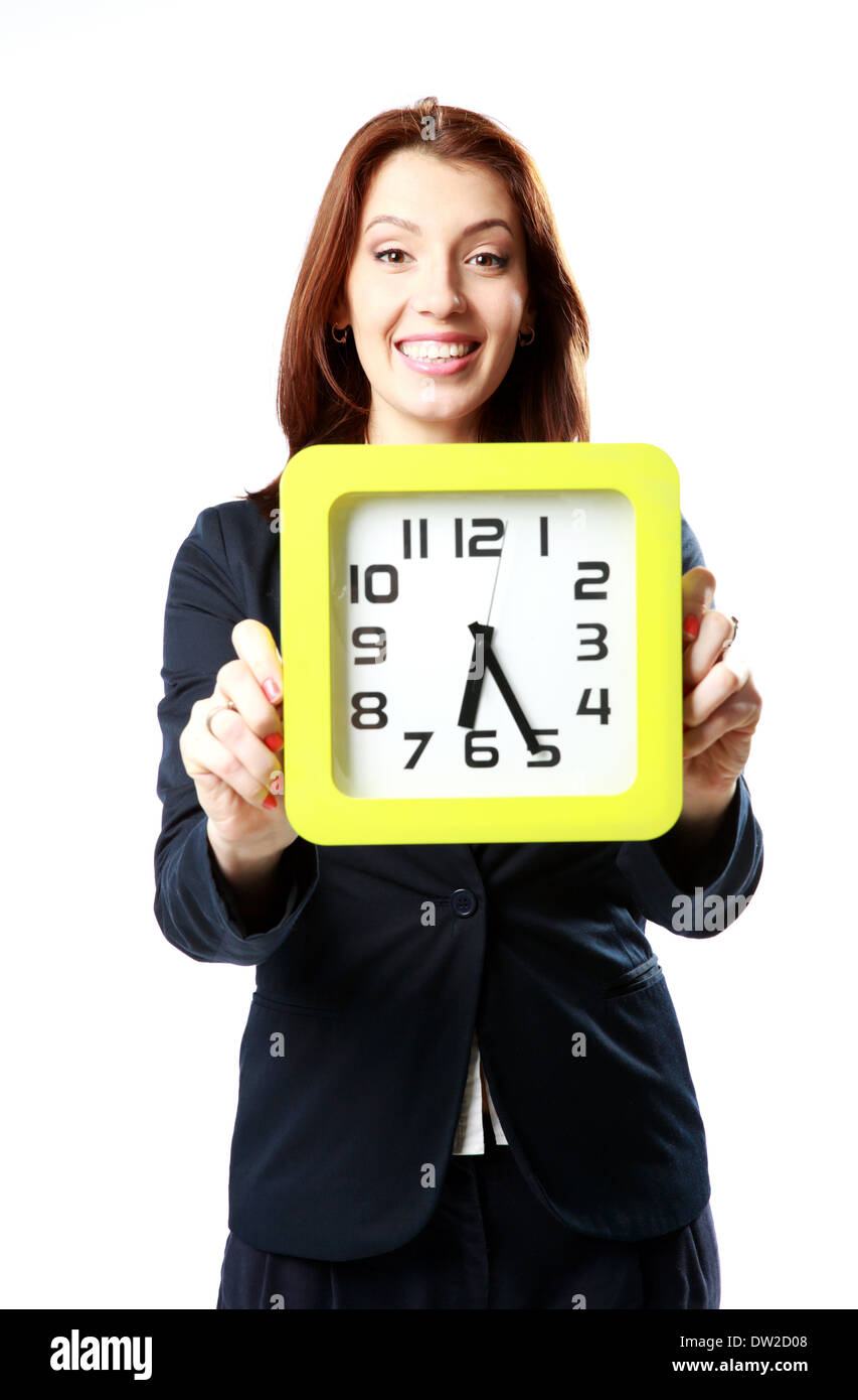 Cheerful businesswoman holding wall clock isolated on white background - Stock Image