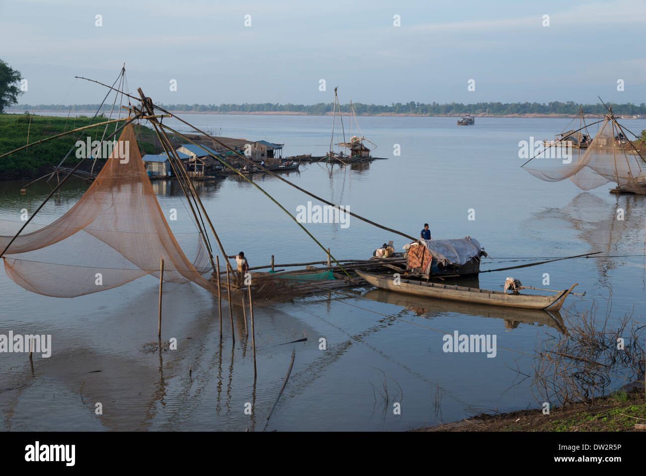 Fishing barge with large net on a Mekong tributary. Kratie area. Cambodia. Stock Photo