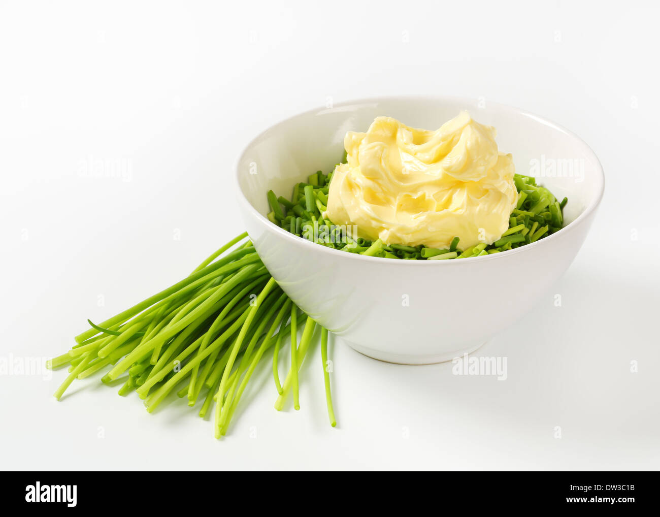 Chopped chives and butter in a bowl - Stock Image