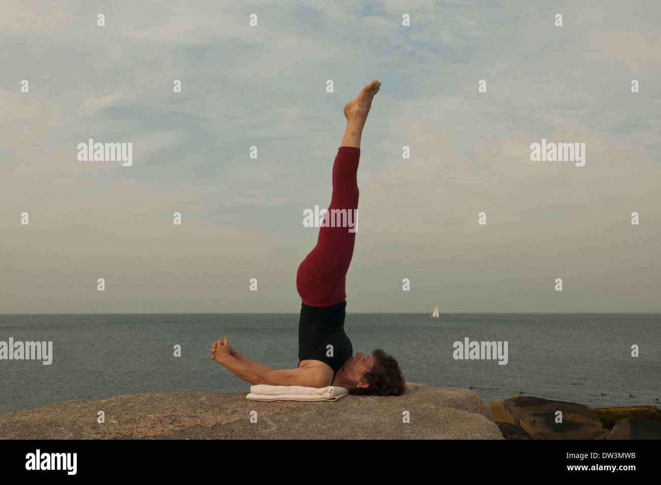 Iyengar Yoga Instructor Demonstrates asana. - Stock Image