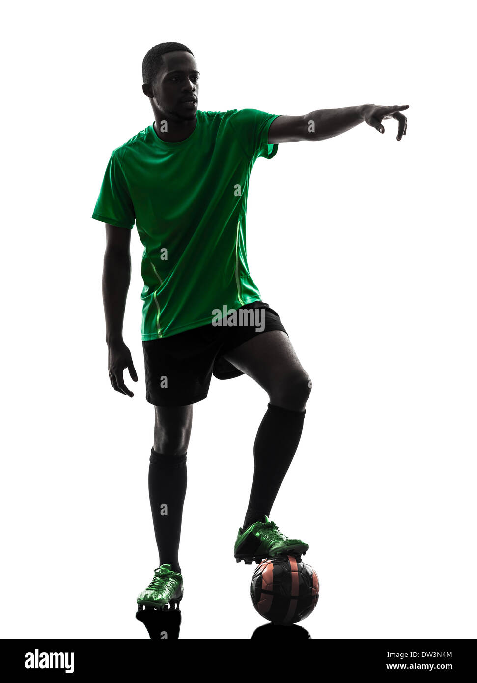 f5748cb20 one african man soccer player green jersey free kick in silhouette on white  background