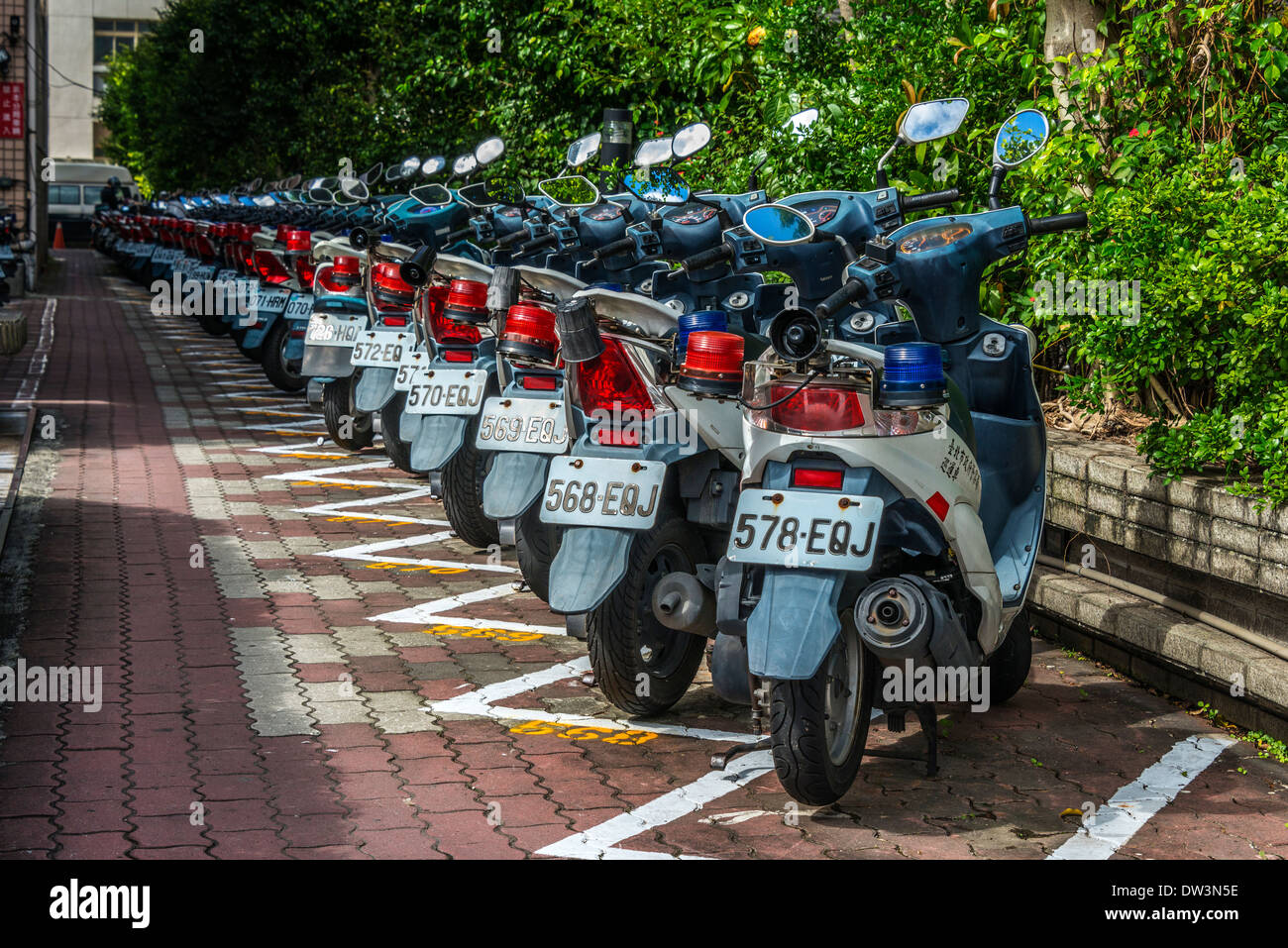 Row of Parked Police Motor Scooters, Taipei, Taiwan - Stock Image