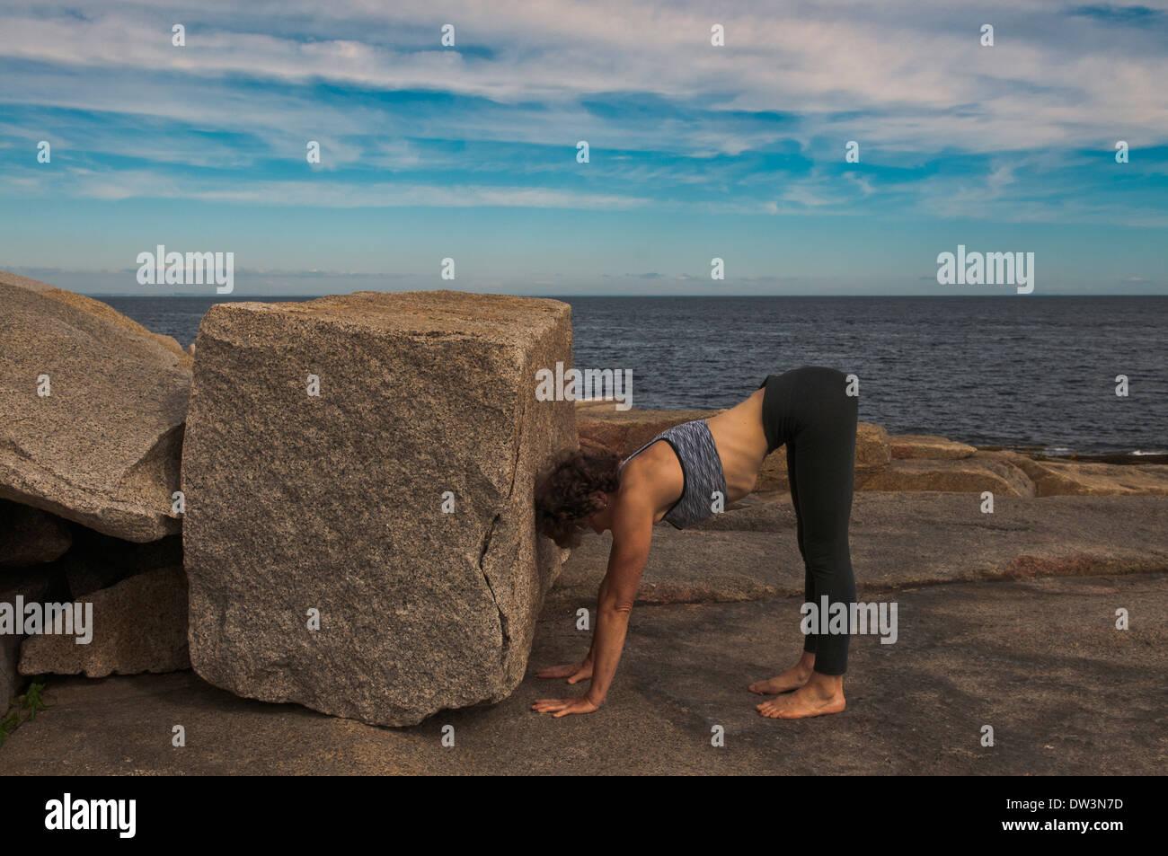 Iyengar Yoga Instructor Demonstrates Adho Mukha Vriksasana preparation (Inverted). Stock Photo