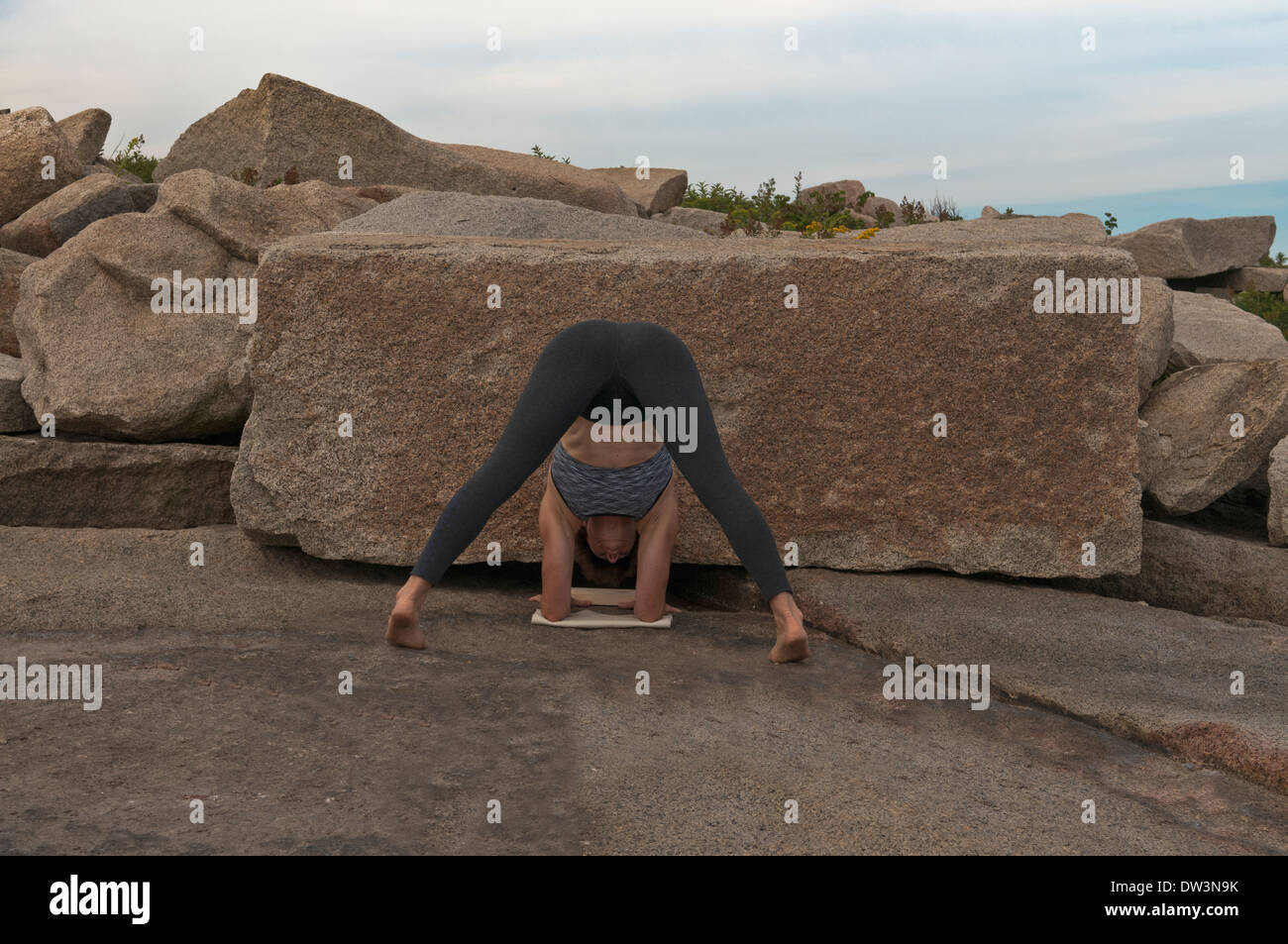 Iyengar Yoga Instructor Demonstrates an asana. - Stock Image