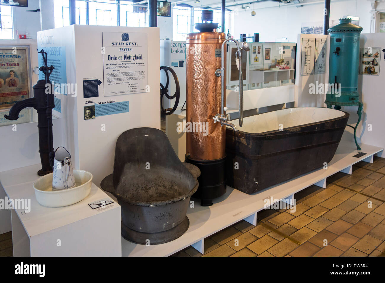 Old 19th and early 20th century bathtubs and heaters at MIAT, industrial archaeology museum, Ghent, Belgium - Stock Image