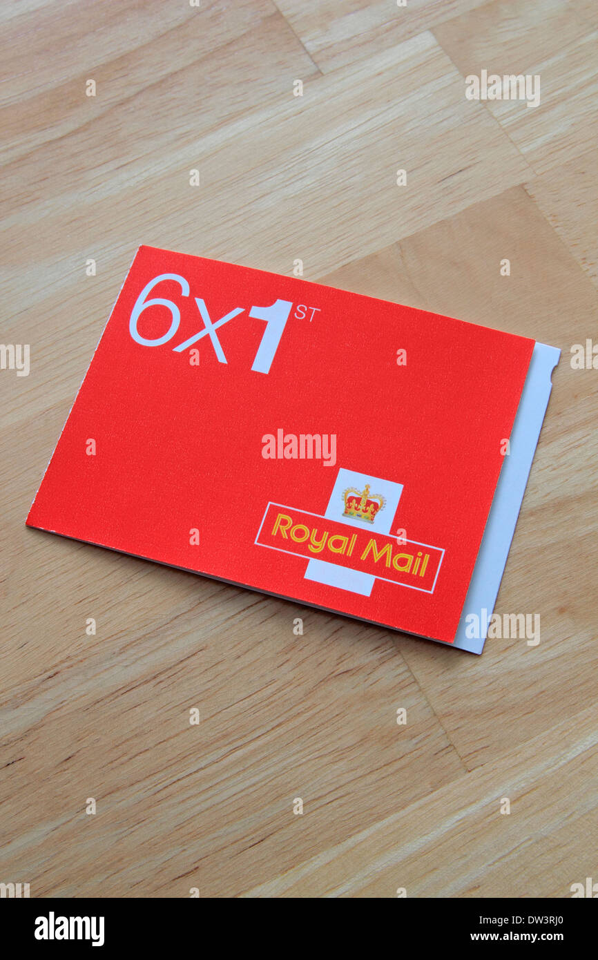 Book of Six 1st Class Stamps on a Wooden Background, UK - Stock Image