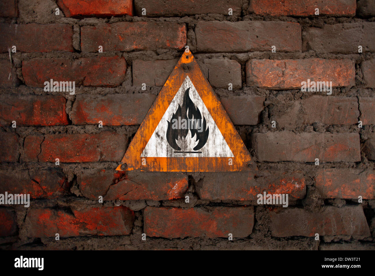 Danger fire signal on a dirty wall - Stock Image