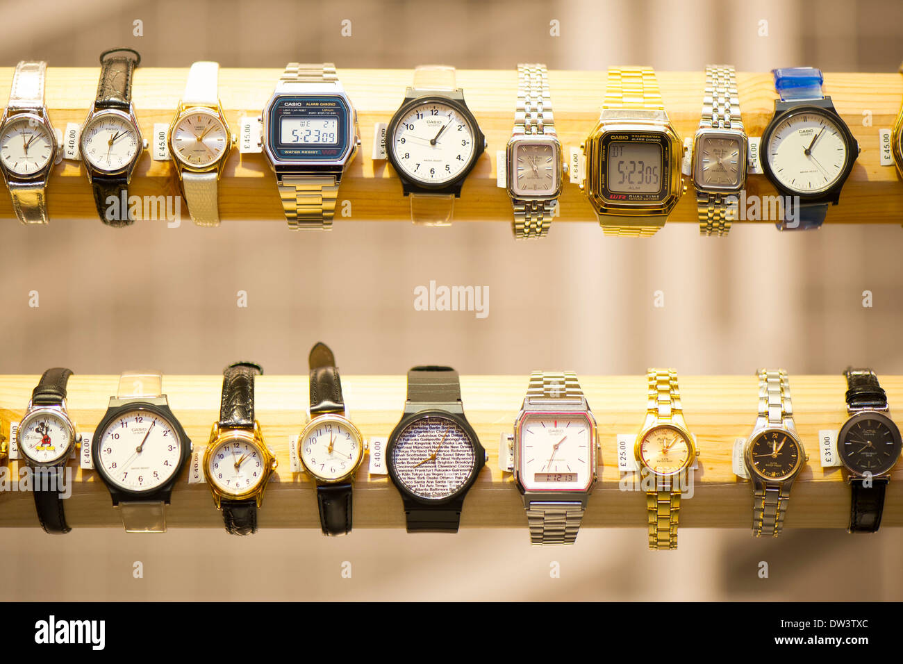 A row of watches for sale in a shop. - Stock Image