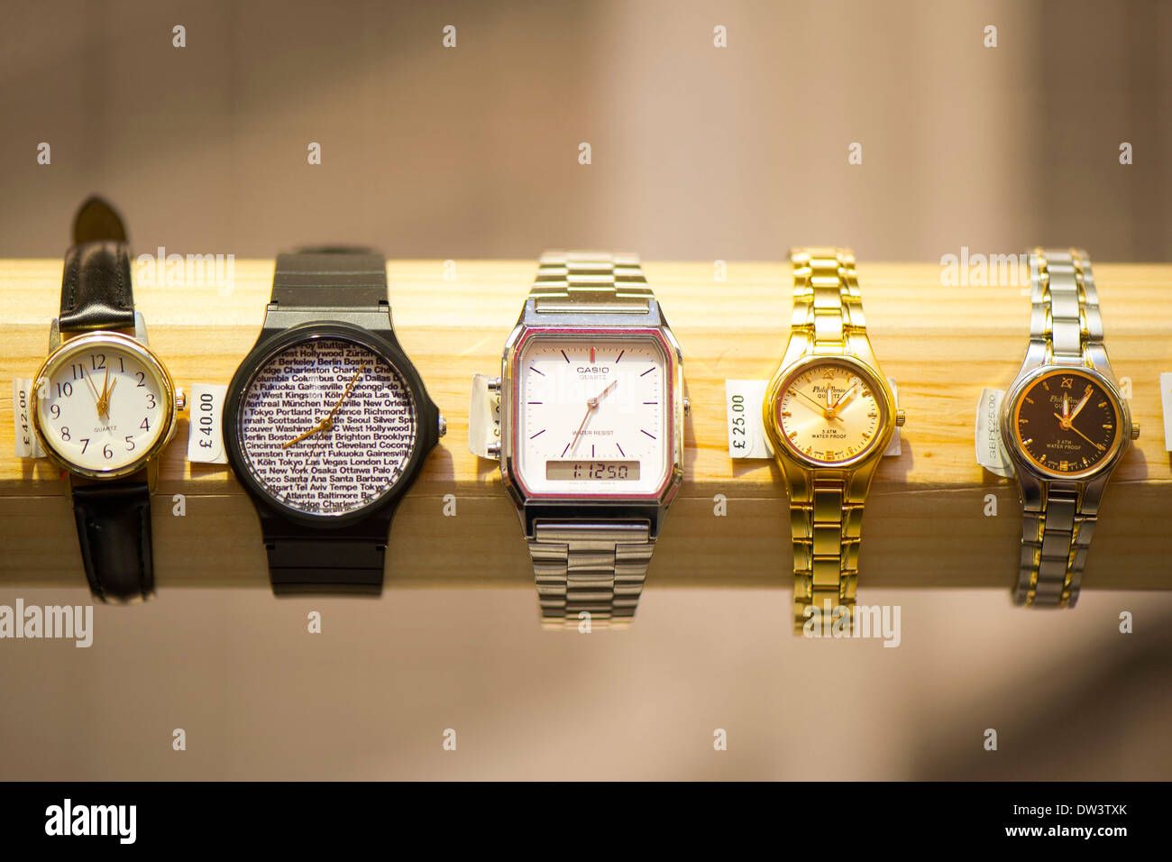 Selection of watches on sale in a shop. - Stock Image