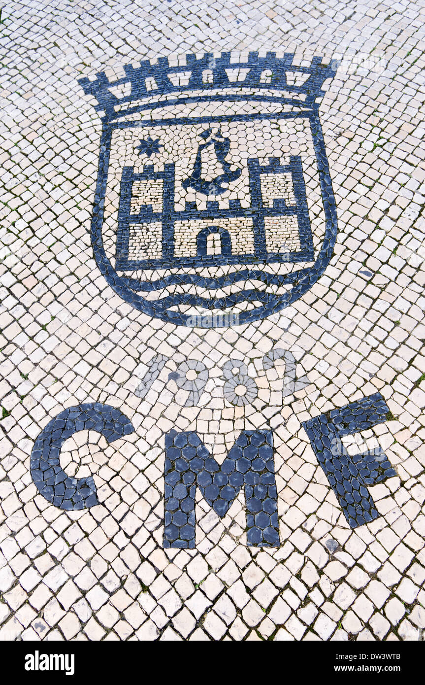 Street mosaic showing coat of arms and the letters 1982 CMF