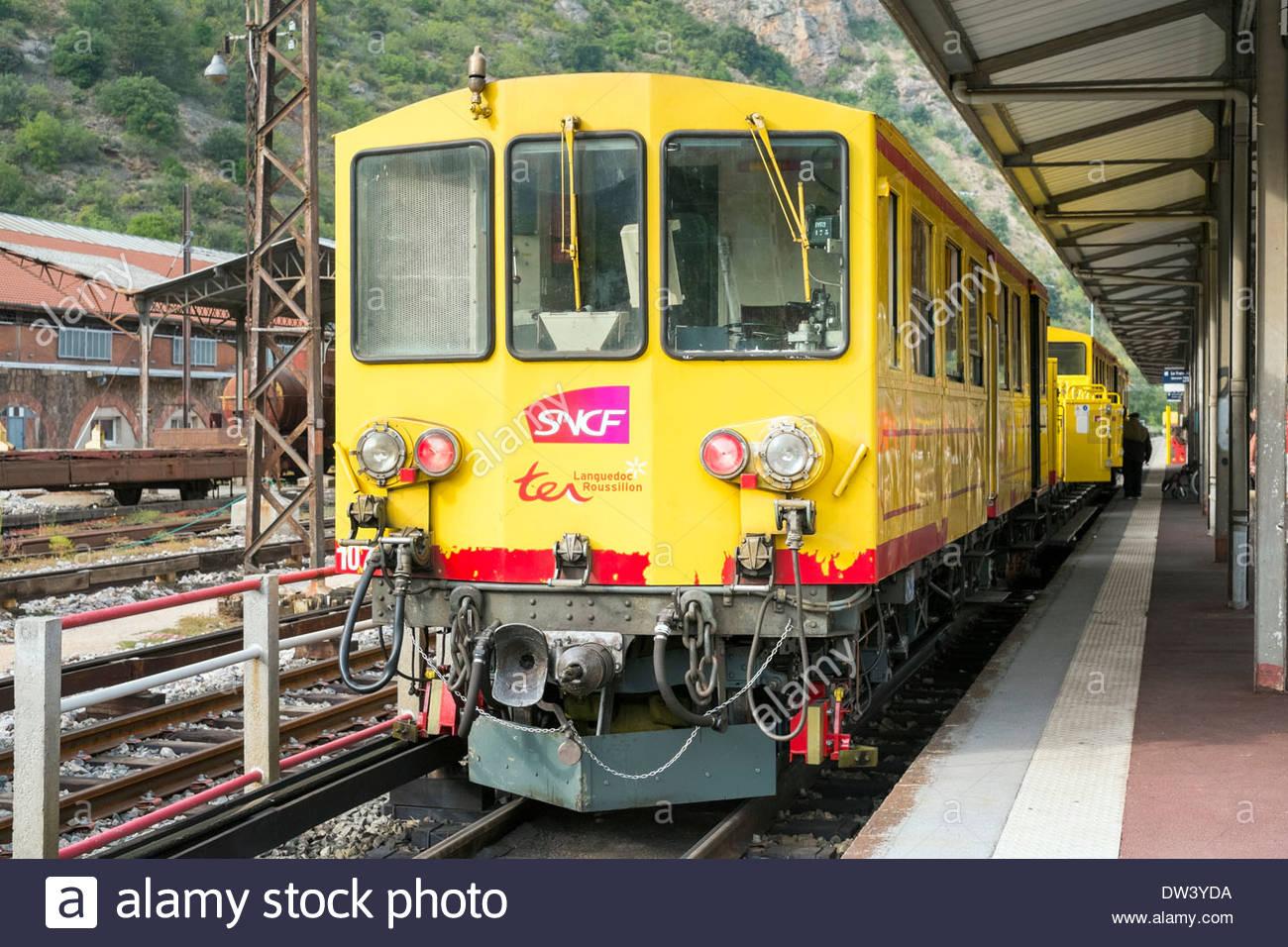 Train Jaune (Yellow Train) at the station in Villefranche-de-Conflent, Pyrénées-Orientales, Languedoc-Roussillon, France - Stock Image