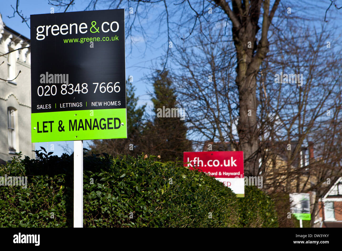 Let and Managed sign outside a property with other For Sale signs in background. Stock Photo
