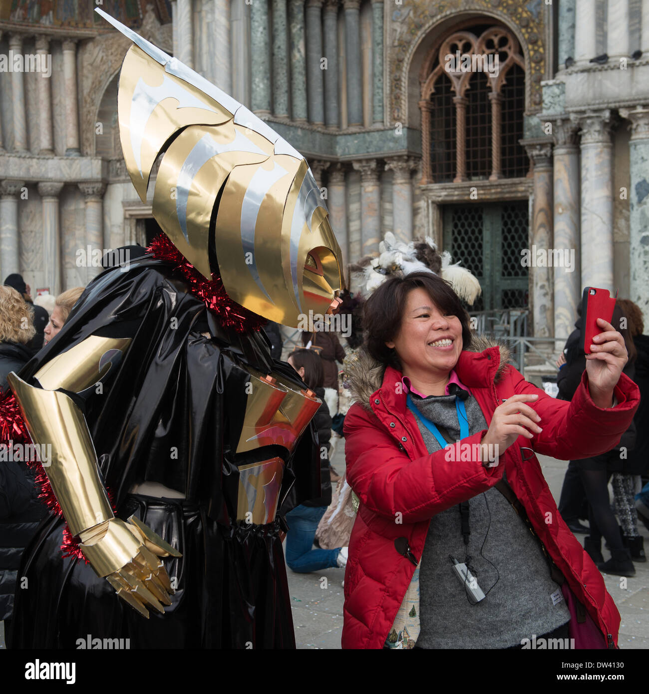 This futuristic female robot costume prompts a tourist to request a photograph with them during the Venice Carnivale - Wednesday 26th February.  sc 1 st  Alamy & Venice Italy. 26th February 2014. This futuristic female robot ...