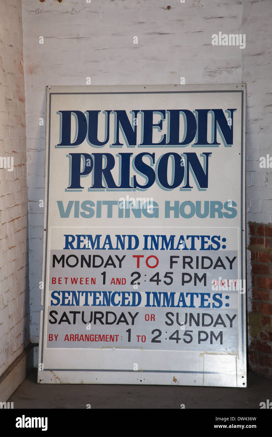 Prison visiting hours sign, Dunedin Prison (1896), Dunedin, South Island, New Zealand - Stock Image