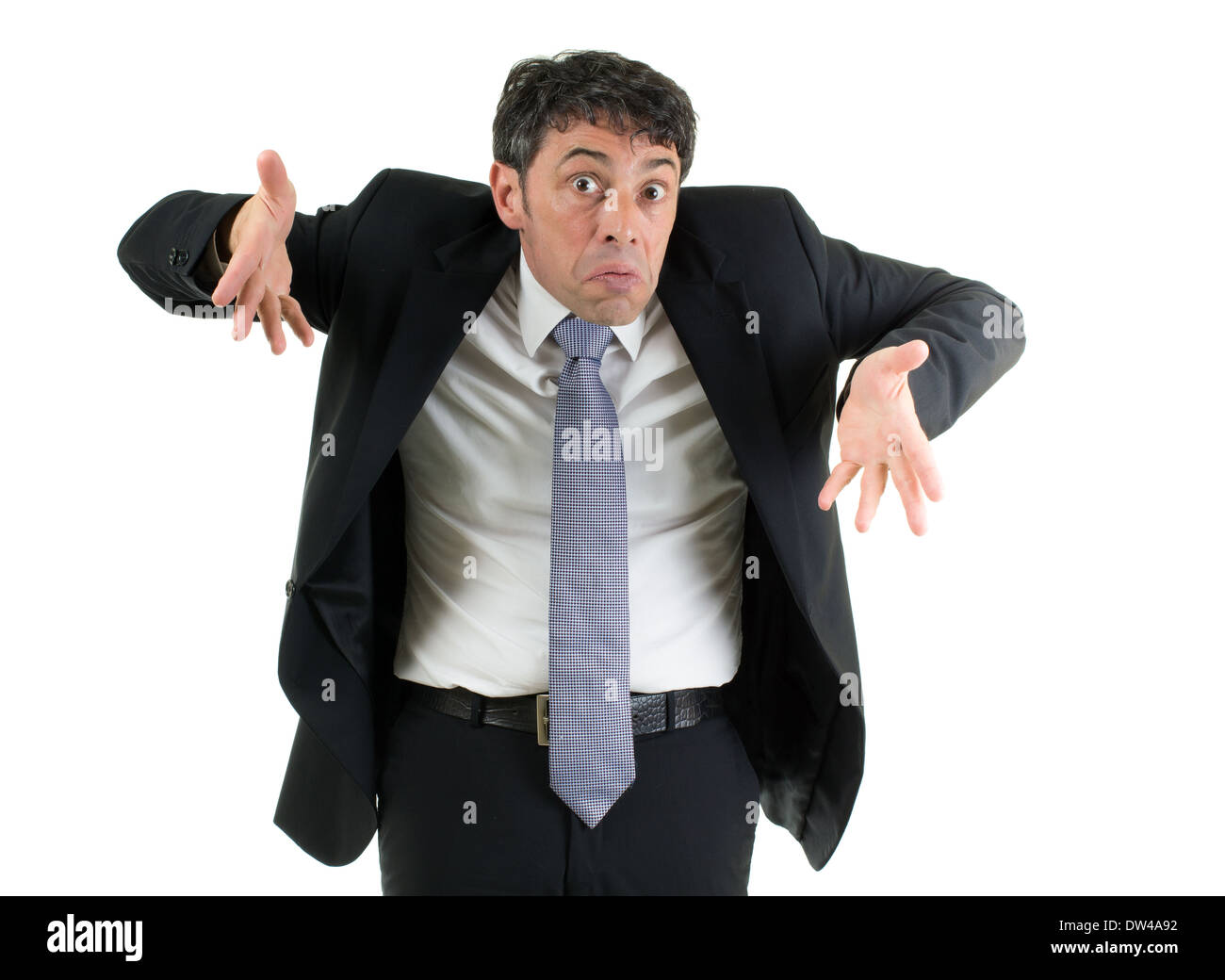 Expressive businessman shrugging his shoulders in ignorance or indifference and gesturing with his hands isolated on white - Stock Image