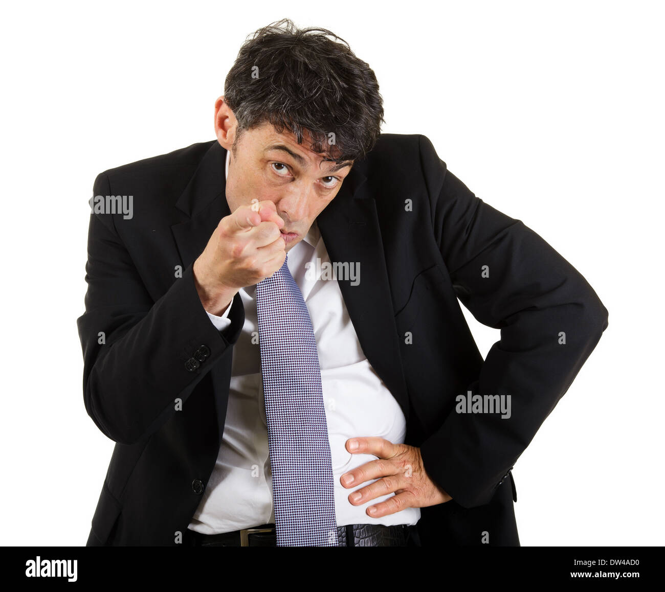 businessman pointing an accusatory finger at the camera identifying and blaming the viewer, upper body portrait isolated - Stock Image