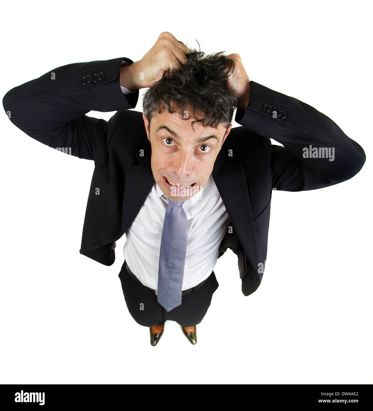 High angle fun portrait of a mature business man tearing out his hair in desperation and frustration isolated on white - Stock Image