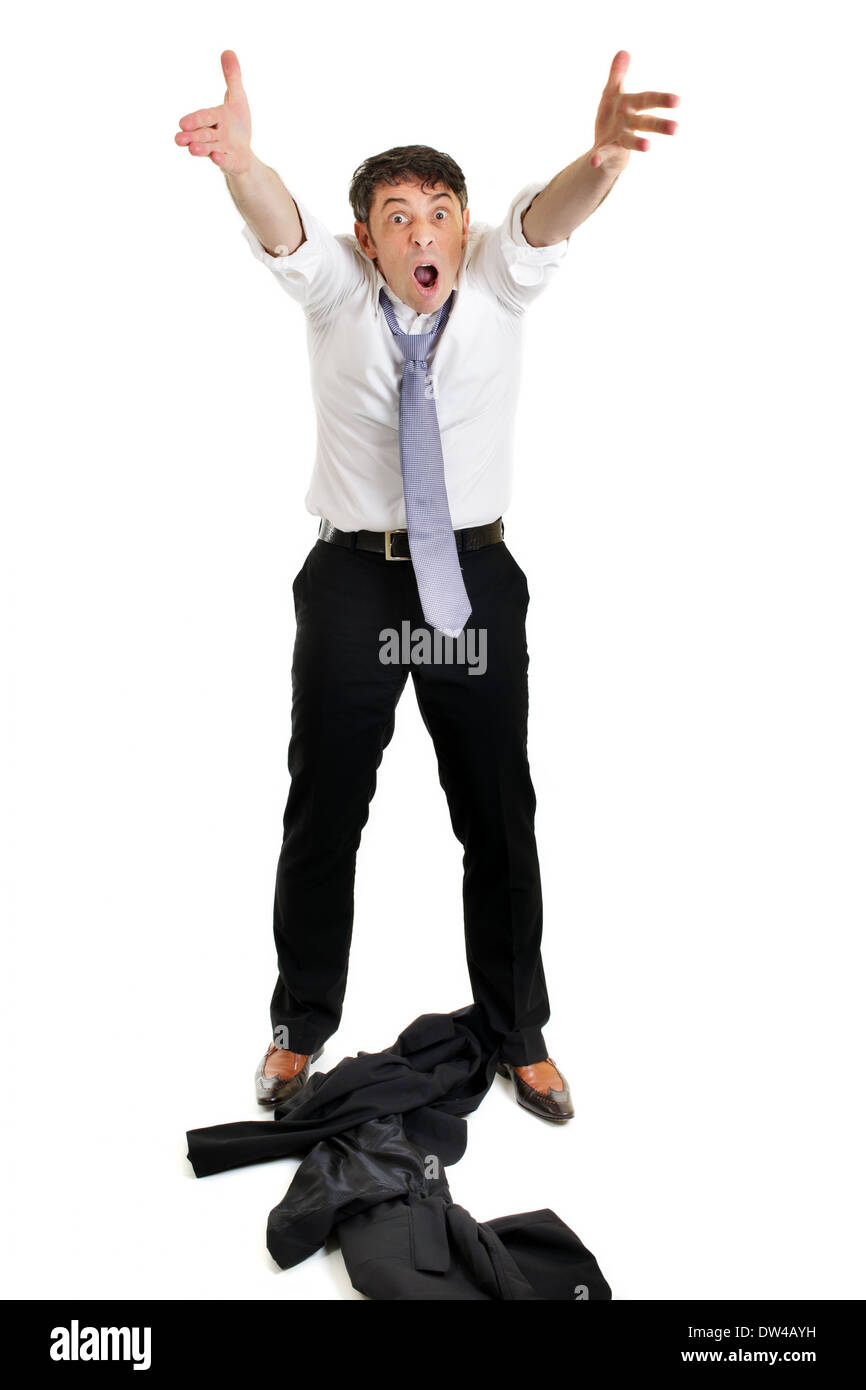 Mature businessman throwing his jacket down on the floor in frustration and anger and raising his arms in the air belligerently - Stock Image