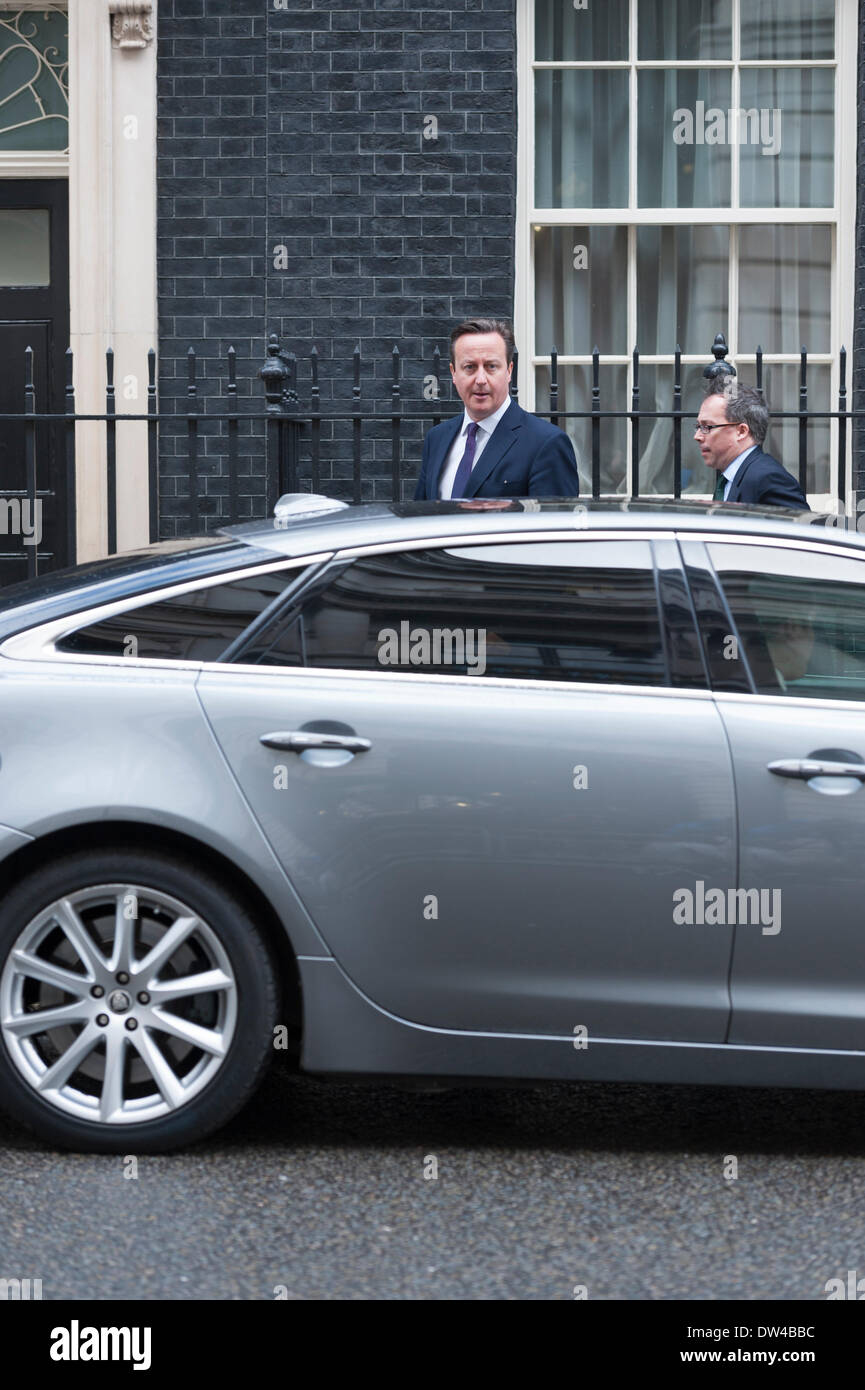 London, UK. 27th February 2014. 27th Feb 2014. British Prime Minister David Cameron sets off from Downing Street Stock Photo