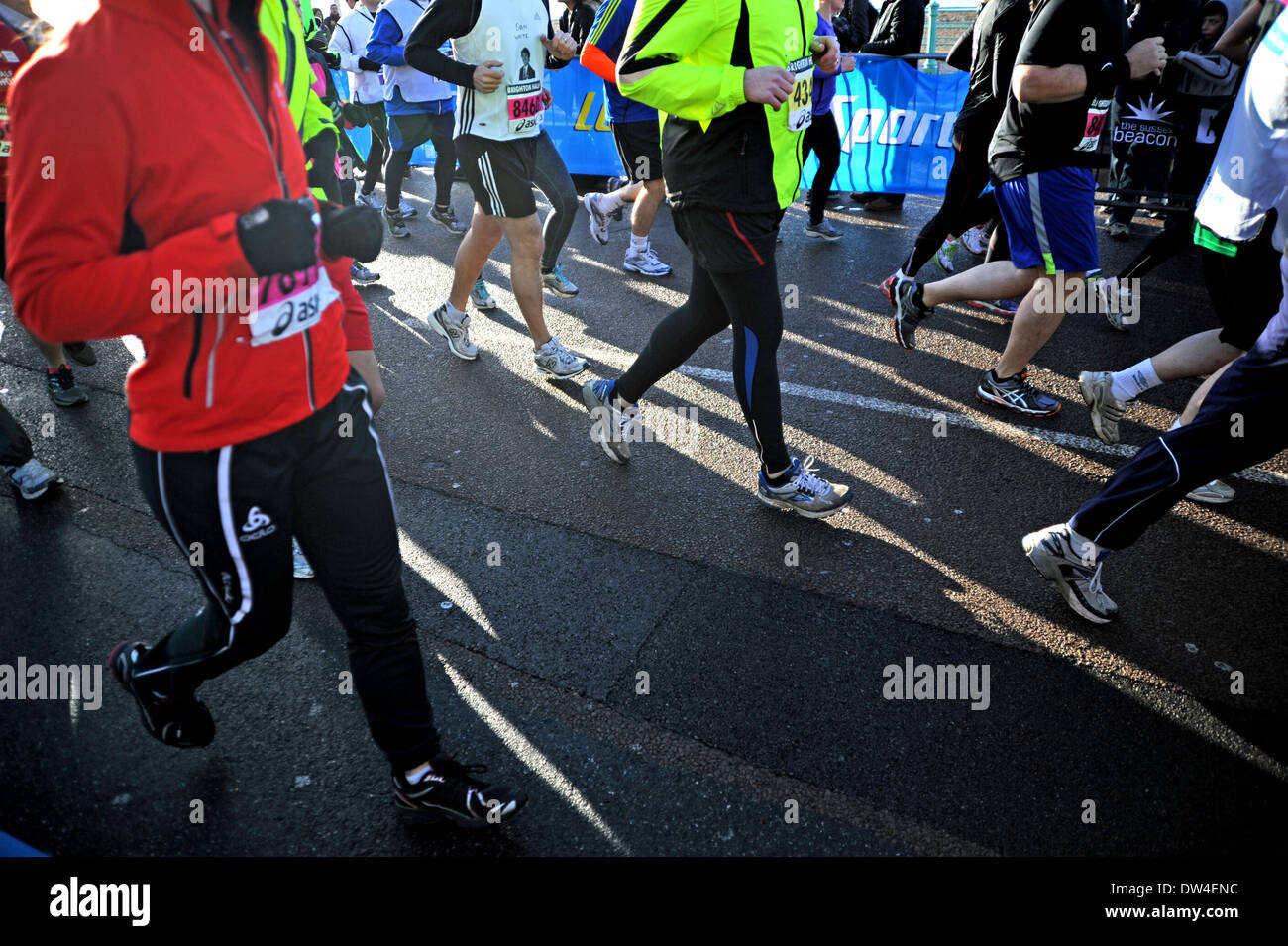 Runners and their training shoes at Brighton half Marathon Race - Stock Image