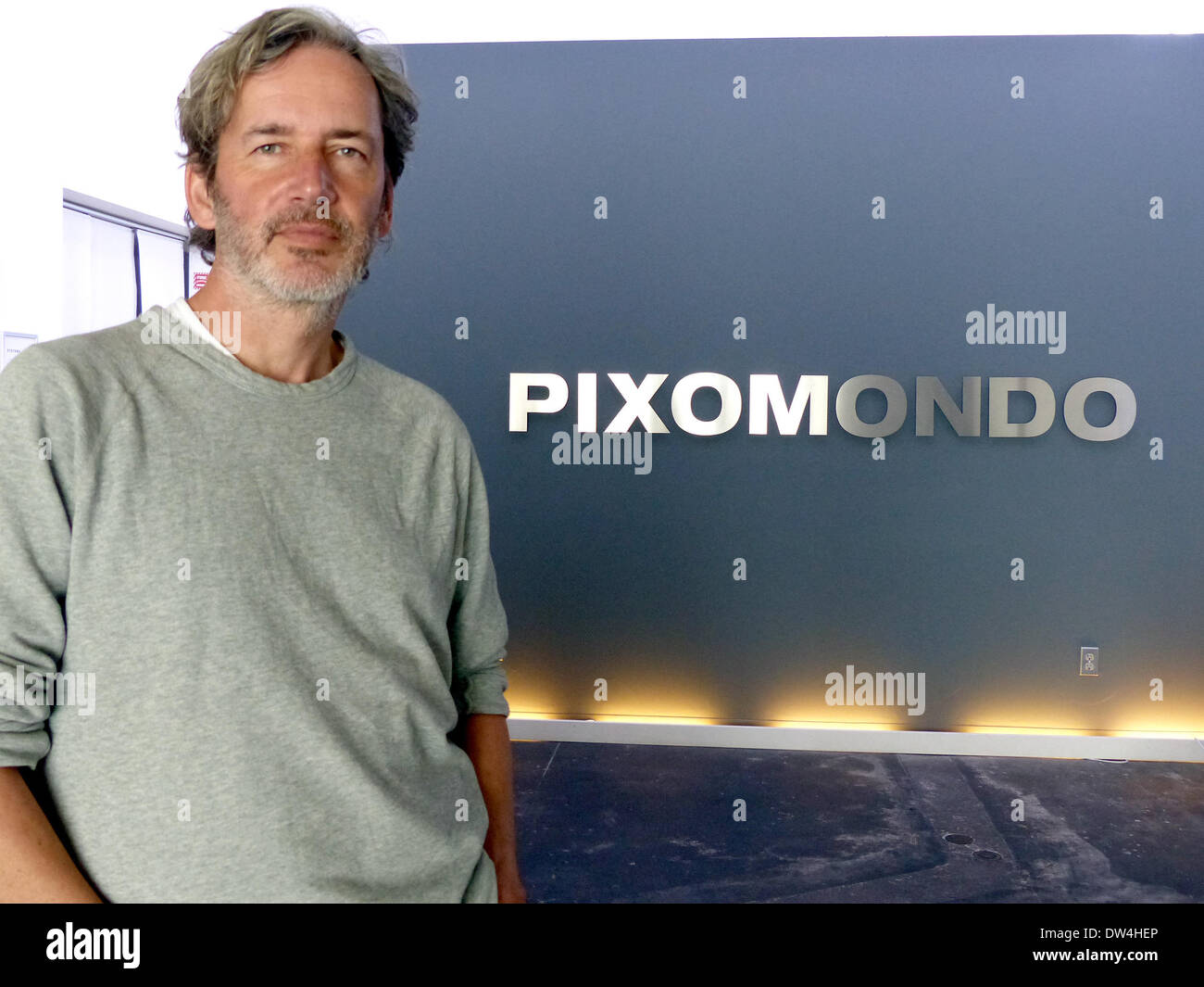 German Thilo Kuther, CEO of special effects company Pixomondo, stands next to the logo of his company in his studion in Santa Monica, USA, 25February 2014. The German effects company could when an Oscar for their work on the science-fiction film 'StarTrek: Into Darkness.' Photo: Barbara Munker - Stock Image