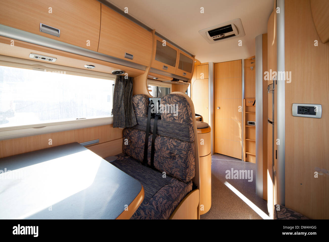 Inside of a Camper van vehicle with dinette, kitchen and cabinets ...