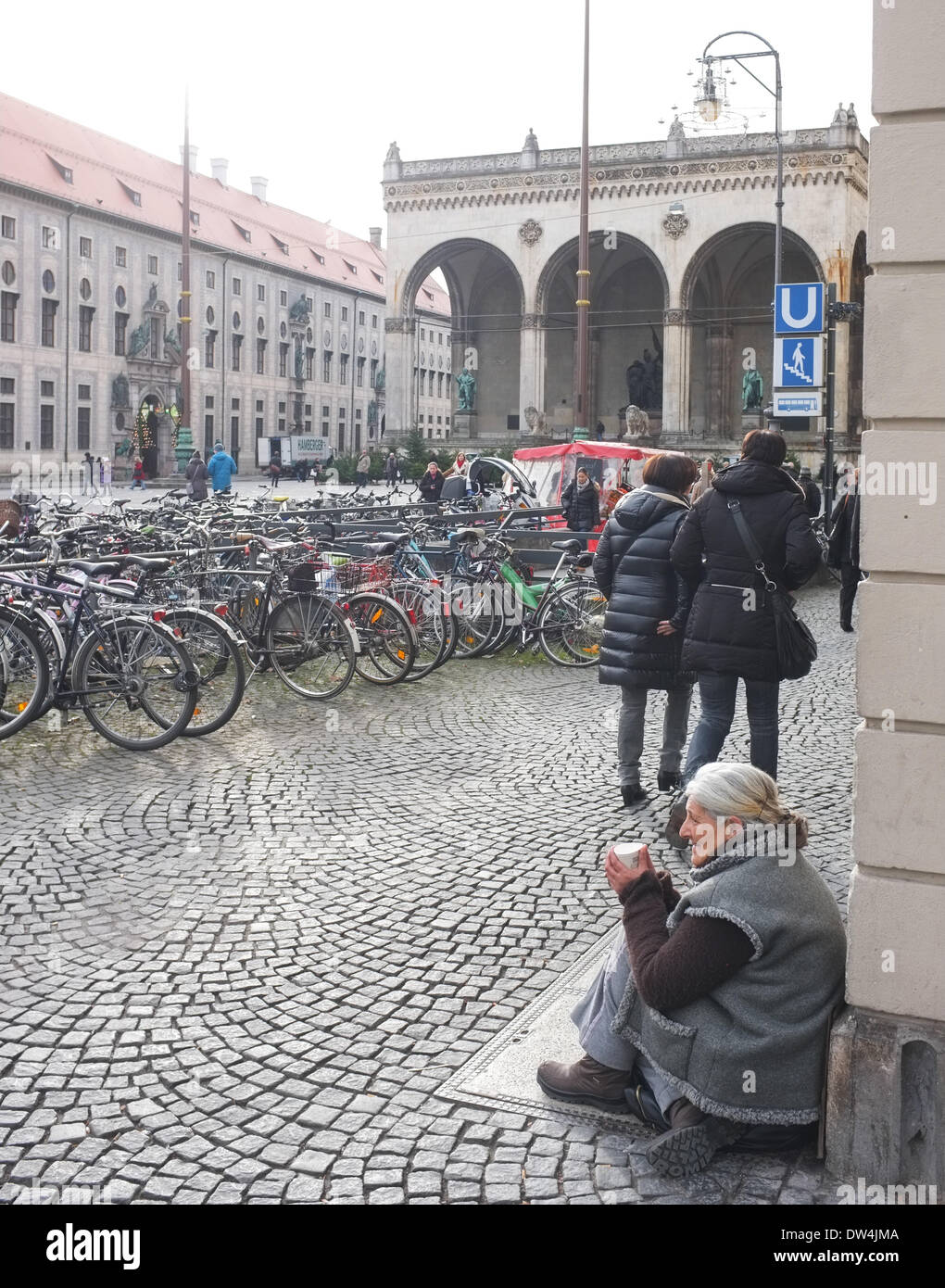 Female beggar in Munich in December 2013. - Stock Image