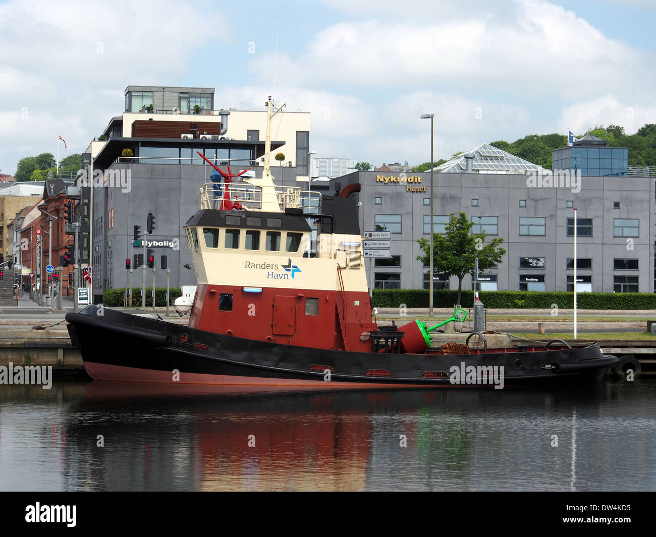 Name: Jens Ove Callsign: OUXP LOA: 19,50 meters Breadth: 5,i80 meters Buildt: Assens Skibsværft (305) 1981 Grosstonnage: 60 tons M/E: B&W Alpha 640 kW, 10 kn Owner: Port of Randers Jens Ove at Randers harbor pic1 - Stock Image