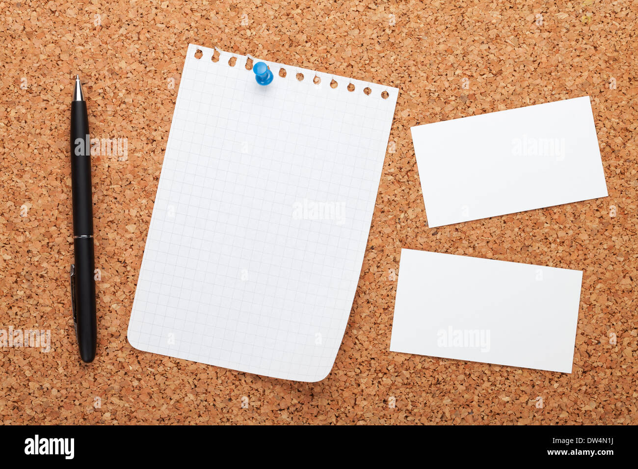 Blank notepad paper, business cards and pen on cork wood notice ...
