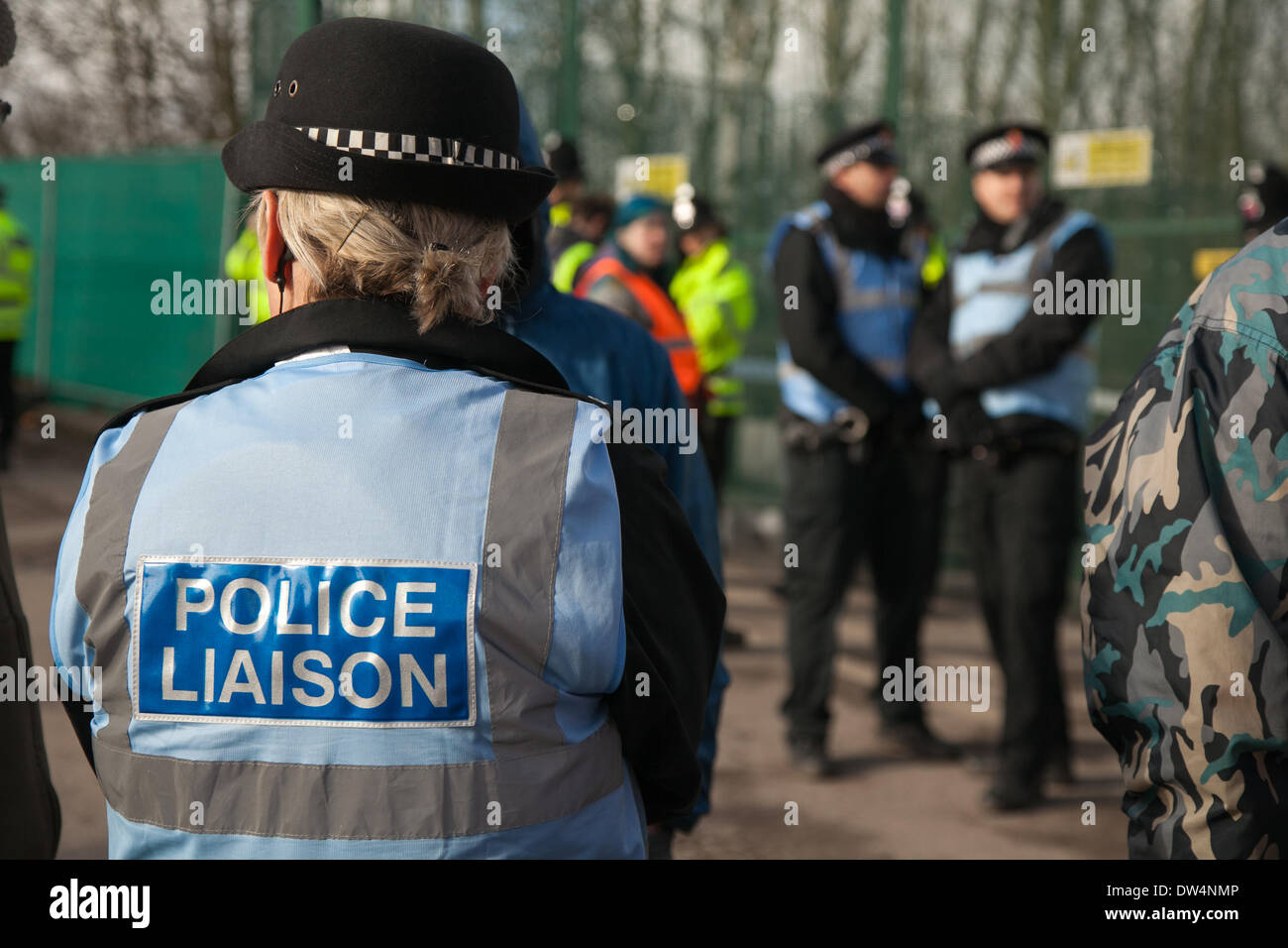 Manchester, Barton Moss, UK. 27th February, 2014.  Protests continue at IGAS Drilling Site.  Greater Manchester Policing operation at Barton Moss Drilling Site as protesters seek to delay and obstruct delivery vehicles and drilling equipment en-route to the controversial gas exploration site. Fracking protestors have set up a camp at Barton Moss Road, Eccles a potential methane-gas extraction site in Salford, Greater Manchester. - Stock Image