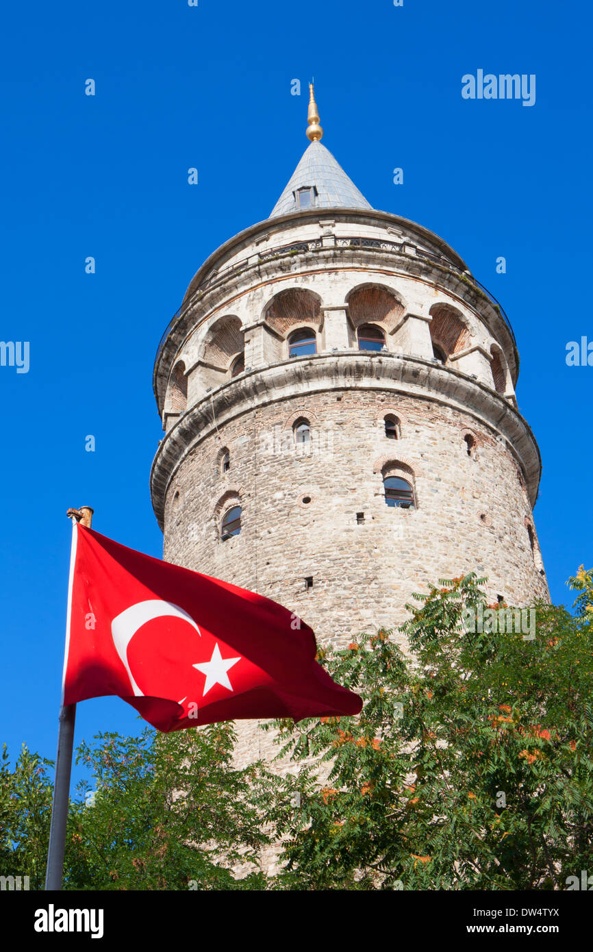 Turkish flag in front of Galata Tower, Istanbul, Turkey - Stock Image