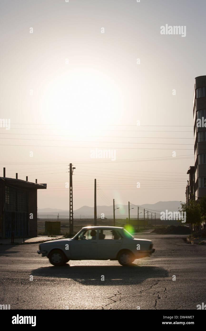 Car on main road sillhouetted, Bazargan, Maku County, West Azerbaijan District, Iran Stock Photo