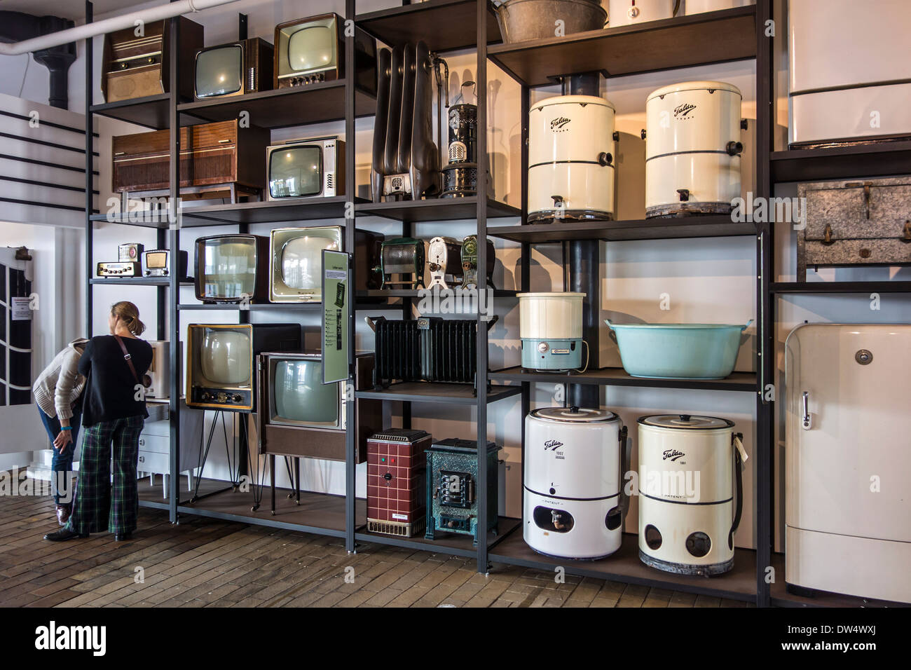 Vintage home appliances like radios, TV sets, heaters, washing machines and refrigerators from the fifties and sixties at MIAT - Stock Image