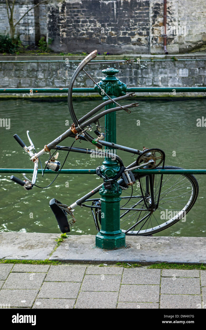 Vandalized bicycle destroyed by frustrated youngster in town - Stock Image