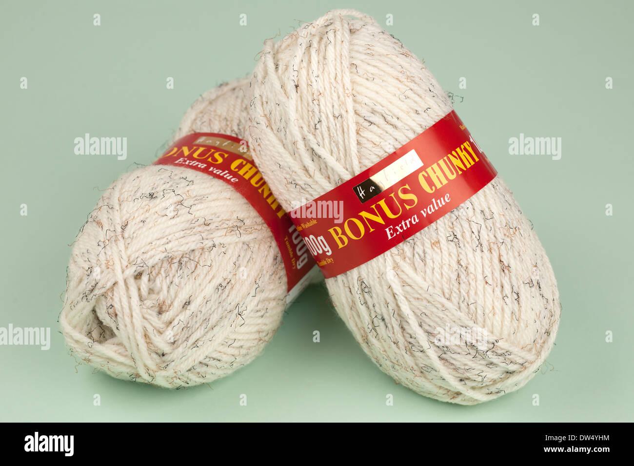 Two 100 gram balls of beige fleck chunky wool - Stock Image