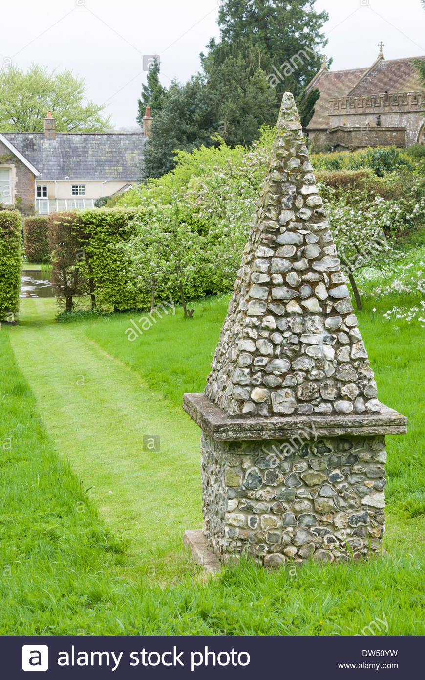 Flint And Stone Obelisk Set At The Head Of One Of The Gardenu0027s Main Axes In  An Orchard. Private Garden, Dorset, UK