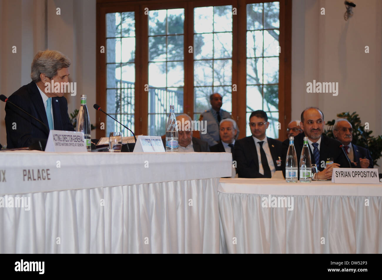 Secretary Kerry Sits Besides Syrian Opposition Coalition President Jarba at Geneva II Conference - Stock Image