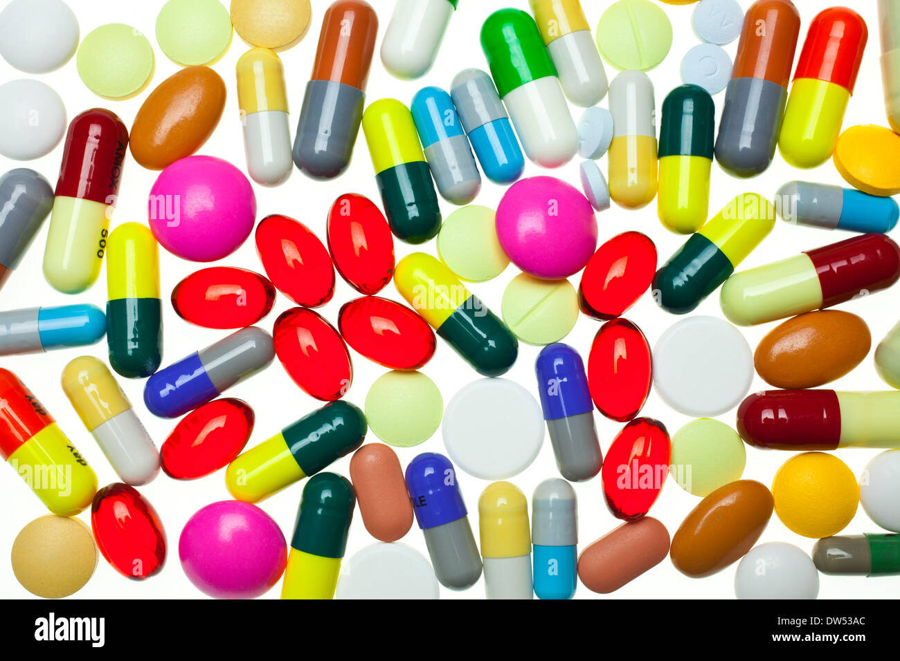 lots of multi-coloured assorted medicines drugs pills on a white background - Stock Image